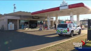 Truck slams into gas station, injuring 4