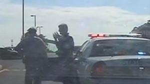 Allegedly drunk state trooper with uniform inside-out confronted by another state trooper after collision