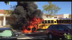School bus catches on fire in front of California school