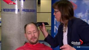 Leslie Horton shaves Paul Brandt's head
