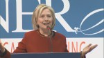 Hillary Clinton jokes about email scandal to political reporters