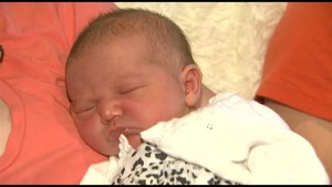 A Kingston family is distraught after their baby was delivered in the main entrance of the hospital