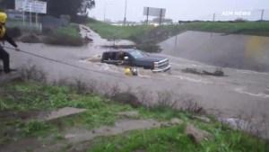Flash floods trap California motorists, deadly tornadoes rip through U.S. southeast