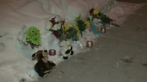 RAW: Mourners lay flowers and candles in front of one of the homes in mass murder