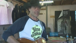 Country music star Corb Lund performs for thrilled buyers at his Calgary garage sale