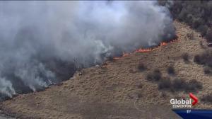 St. Albert firefighter has close call while battling grass fire
