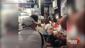 Travellers at Istanbul airport take cover from explosions, gunfire