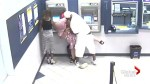 Video shows woman being robbed at ATM, witness continues to withdraw money