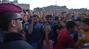 Raw video: Heated standoff between police, refugees in Hungary