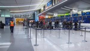 Naked man arrested at U.S. airport after assault elderly man