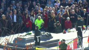 Canadians gather around War Memorial in Ottawa