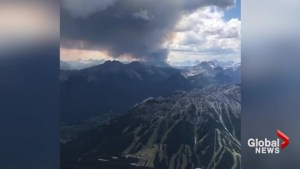 Smoke from wildfires rises above Banff mountain tops