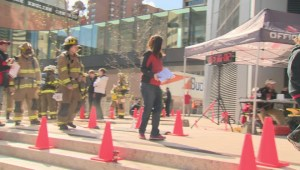 Calgary Firefighters climb and conquer The Bow building
