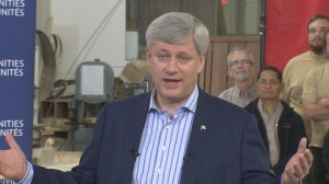 Harper praises budget and defends hockey jersey choice during visit to Winnipeg