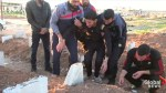 Syrian man who lost over 20 members of his family in alleged gas attack sobs at their grave site