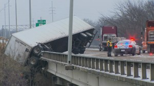 RAW: Semi hangs off bridge in Texas