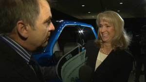 Executives all smiles after grabbing Canadian International Auto Show awards