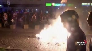 Fire burns on Hamburg, Germany street as protesters clash with police