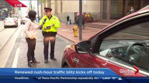 Police ticket driver during parking blitz live on TV