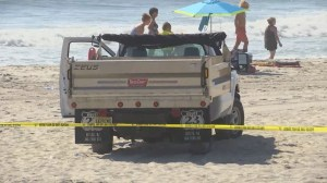 Canadian woman lying on New Jersey beach run over by truck collecting garbage