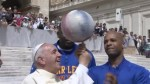 Pope Francis shows off his basketball skills with the Harlem Globetrotters