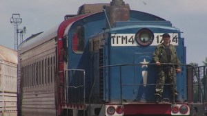 Train carrying crash victims' remains arrives in Ukraine-held city