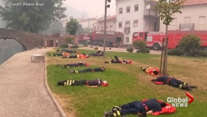 Firefighters enjoy a rare break from battle against Portuguese forest fires