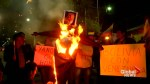 Bolivians burn effigy of Trump outside U.S. embassy