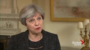 Theresa May promises a national inquiry into cause of the Grenfell Tower fire