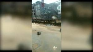 Caught on Camera: Heavy rains, floods cause apartment building to collapse in China