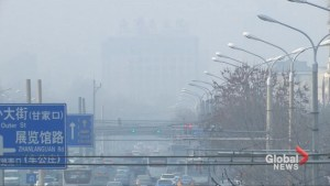 Beijing wheezes through another day of smog