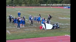 Youth football team runs into banner with disastrous results