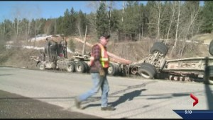 Driver escapes uninjured from rolled logging truck
