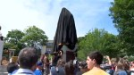 Halifax government covers controversial statue with drape to appease protesters