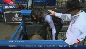 Global's Melissa Nakhavoly attempts a professional bull ride