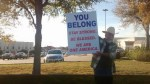 Man holds 'You Belong' sign outside Texas mosque to encourage Muslim neighbours