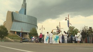 The grand opening of the CMHR faces protesters.