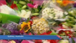 Australian PM lays flowers at memorial for Sydney standoff victims