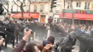 Police deploy pepper spray, tear gas against climate change protesters in Paris