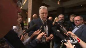 Quebec Premier defends his party