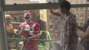 Window washer superheroes surprise kids in hospital