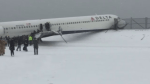 Passenger films aftermath of plane that skidded off runway at LaGuardia airport