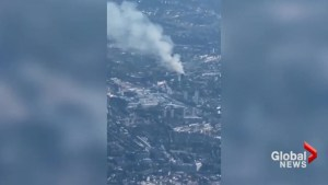 Airplane passenger captures massive plume of smoke rising from London apartment fire