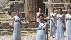 Olympic torch is officially lit in lavish ceremony