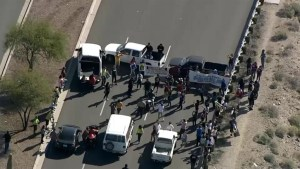 Protesters block off intersection to Trump rally