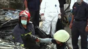 Investigators at scene of Taiwan plane crash which killed 48 passengers