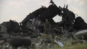 Pro-Russian militia inspect wreckage of downed military transport plane
