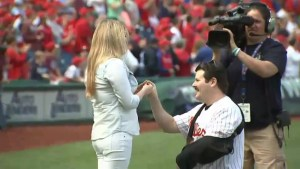 Cop shot by ISIS-inspired gunman 'pops the question' live on the field at Phillies game