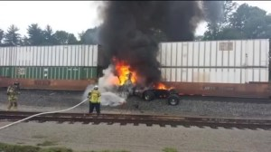 Massive fireball as train slams into stopped semi-truck