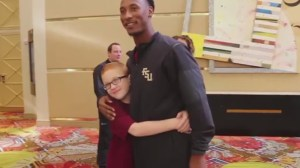 Florida State's Travis Rudolph gives custom jersey to boy with autism